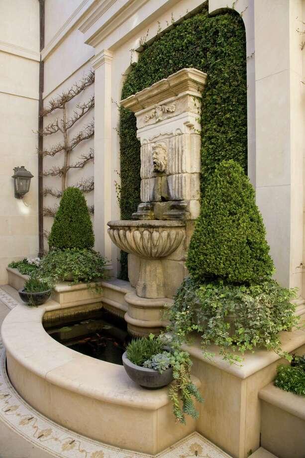 Symmetry helps create a restful courtyard in a garden featured on the  River Oaks Garden Club's Azalea Trail.  Photo: John Everett / John Everett