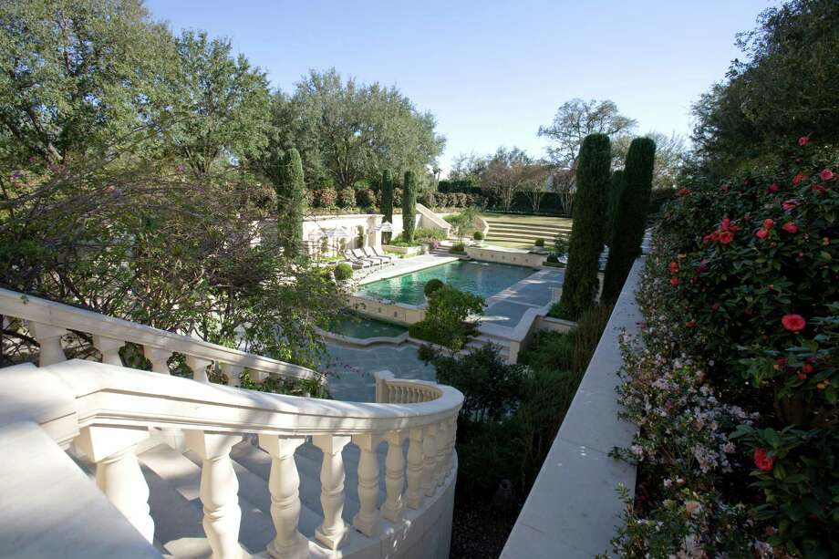 A sunken pool loggia and terraced lawn are highlights in an expansive garden on the River Oaks Garden Club's Azalea Trail. Photo: John Everett / John Everett