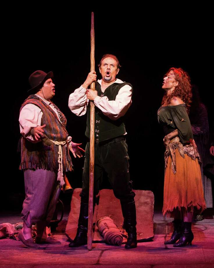 "Josh Lamon, left, Paul Schoeffler and Michelle DeJean star in ""Man of La Mancha"" at the Hobby Center. Photo: Bruce Bennett / Bruce Bennett 2013 and beyond"