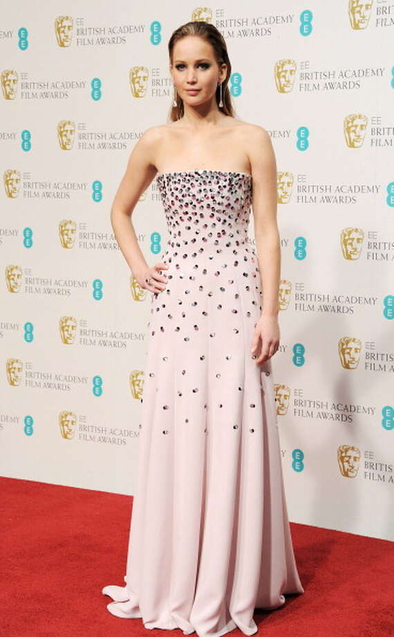 Dressed in Christian Dior Couture, Jennifer Lawrence poses in the Press Room at the EE British Academy Film Awards at The Royal Opera House on February 10, 2013 in London, England. Photo: Dave M. Benett, Getty Images / 2013 Dave M. Benett