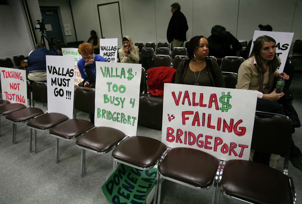 Signs against retaining Supt. of Schools Paul Vallas are placed on chairs before the start of the Bridgeport Board of Education meeting at the Aquaculture School in Bridgeport on Monday, February 25, 2013. Many in attendance also sat with signs in support of Vallas.