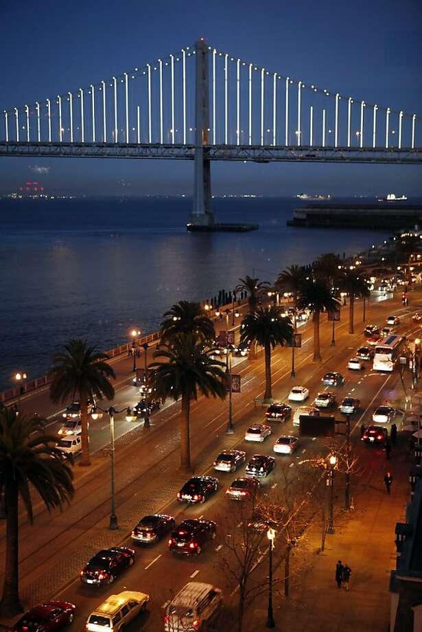The San Francisco Bay Bridge is alight as artist Leo Villareal tests his Bay Lights installation on Thursday, February 28, 2013, in San Francisco, Calif. Photo: Carlos Avila Gonzalez, The Chronicle