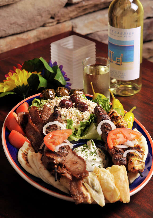 The Papouli's Feast at Papouli's Greek Grill features 1/4 pound each of sirloin steak, chicken, and lamb skewers with gyro, topped with onions and tomatoes, tossed Greek salad with feta cheese and vinaigrette dressing, dolmas, spanikopita, tyropita, tzatziki sauce and pita's. Photo: ROBIN JERSTAD, SPECIAL TO THE EXPRESS-NEWS / Robin Jerstad 210-254-6552