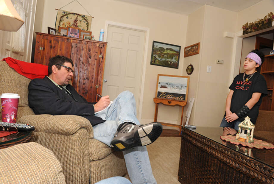 Times Union reporter Mark McGuire interviews heavy metal guitar prodigy Joe Pettinato, 13, at his home on Thursday Feb. 14, 2013 in Colonie, N.Y. Photo: Lori Van Buren