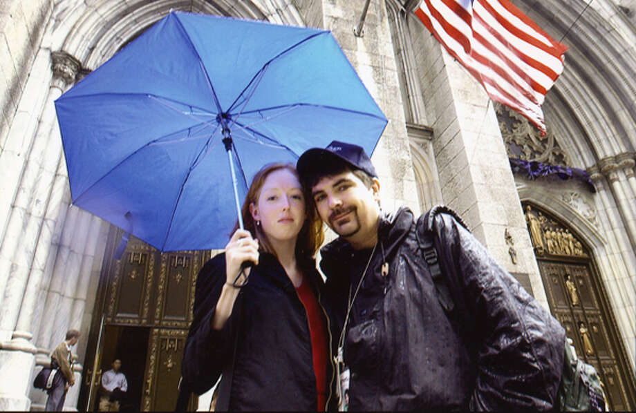 While on assignment in Manhattan two days after the Sept. 11 attacks, Mark McGuire bumped into his niece, Laurie McGuire, outside of St. Patrick's Cathedral. Photo: Michael P. Farrell