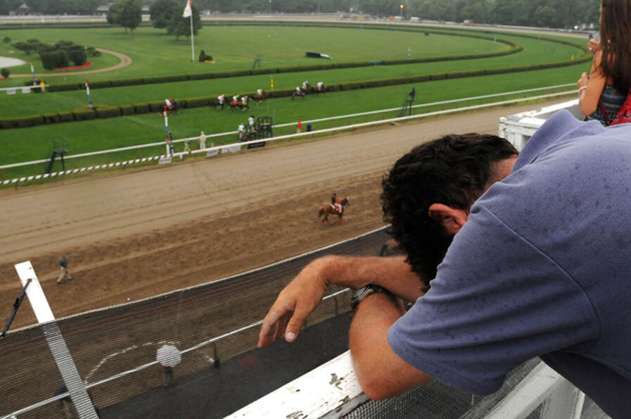 Times Union reporter Mark McGuire hangs his head after losing another race at Saratoga Race Course i