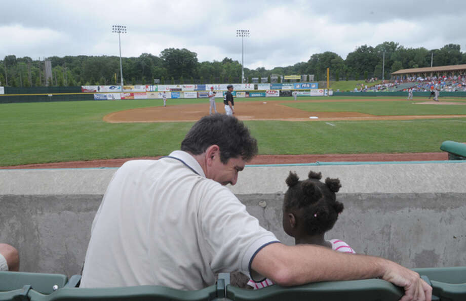 Times Union writer Mark McGuire and his daughter watch Tri-City Valley Cats play against the Lowell