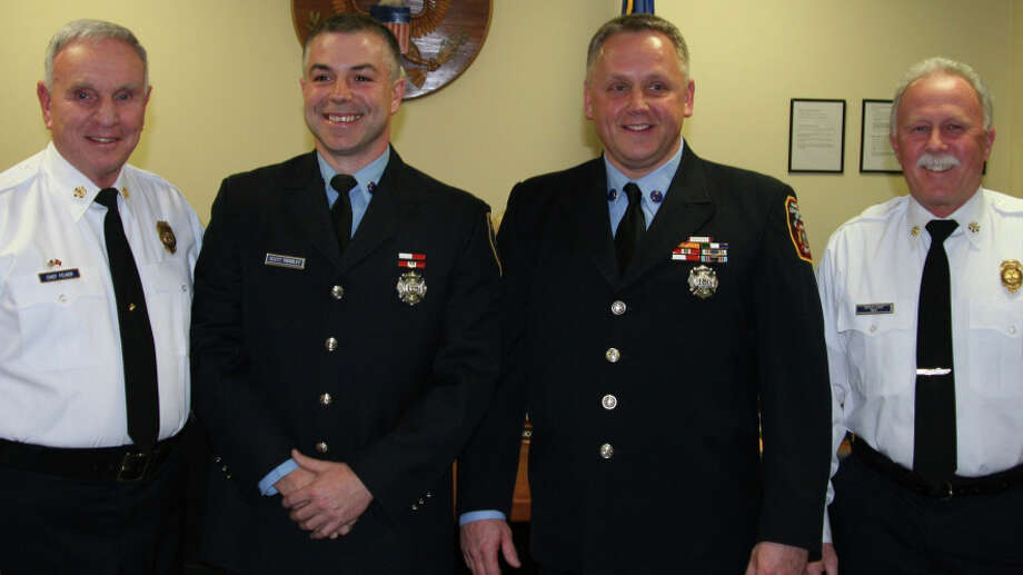 New promoted fire lieutenants, Scott Tembley, second from left, and Brian McHugh, second from right, with Fire Chief Richard Felner, left, and Deputy Chief Art Reid at a recent Fire Commission meeting where their promotions were approved. Photo: Fairfield Fire Department / Fairfield Citizen contributed