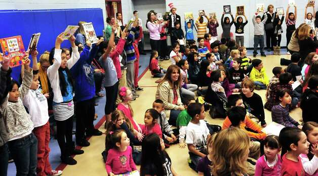 Fourth-graders perform during a celebration of Dr. Seuss' birthday, at Ellsworth Avenue School in Danbury, Conn.,. during a Read Across America event. A flash mob, led by pre-education students from Western Connecticut State University, surprised students at the end of an awards assembly Friday, March 1, 2013. Photo: Michael Duffy / The News-Times