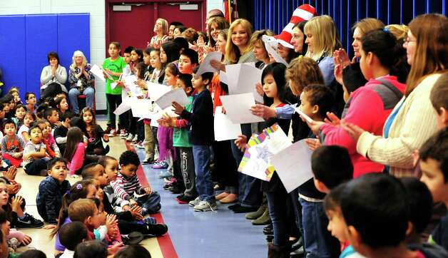 Students get awards during a celebration of Dr. Seuss' birthday, at Ellsworth Avenue School in Danbury, Conn.,. during a Read Across America event. A flash mob, led by pre-education students from Western Connecticut State University, surprised students at the end of an awards assembly Friday, March 1, 2013. Photo: Michael Duffy / The News-Times