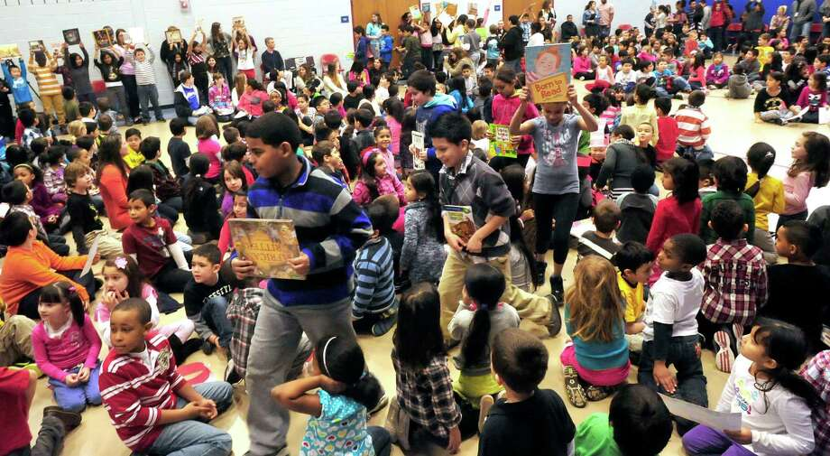 Students take part in a flash mob during a celebration of Dr. Seuss' birthday, at Ellsworth Avenue School in Danbury, Conn.,. during a Read Across America event. The flash mob, led by pre-education students from Western Connecticut State University, surprised students at the end of an awards assembly Friday, March 1, 2013. Photo: Michael Duffy / The News-Times