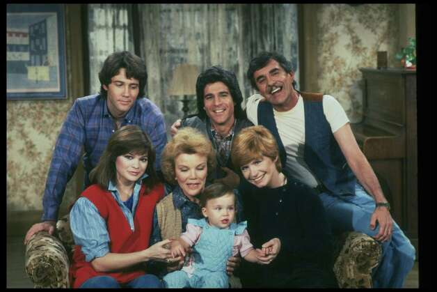 """One Day at a Time"" cast members (clockwise from upper right) Pat Harrington, Jr. as Schneider, Bonnie Franklin as Ann Romano Royer, (child unidentified), Nanette Fabray as Grandma Katherine Romano, Valerie Bertinelli as Barbara Cooper Royer, Boyd Gaines as Mark Royer and Michael Lembeck as Max Horvath. Photo: CBS Photo Archive, Getty / 1982 CBS Photo Archive"