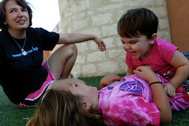 Marley Bedford, 3, plays with her sister, Delaney Bedford, 7, while their mother, Crystal Bedford, sits with them in the play area at Sweet Marley's in Fredericksburg on September 25, 2012. Photo: Lisa Krantz, San Antonio Express-News / © 2012 San Antonio Express-News