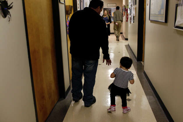 Marley Bedford, 3, walks with her father, Jonathan Bedford, after getting a casting for leg braces at Prescott's Orthotics and Prosthetics in San Antonio on Dec. 29, 2012. Photo: Lisa Krantz, San Antonio Express-News / © 2012 San Antonio Express-News