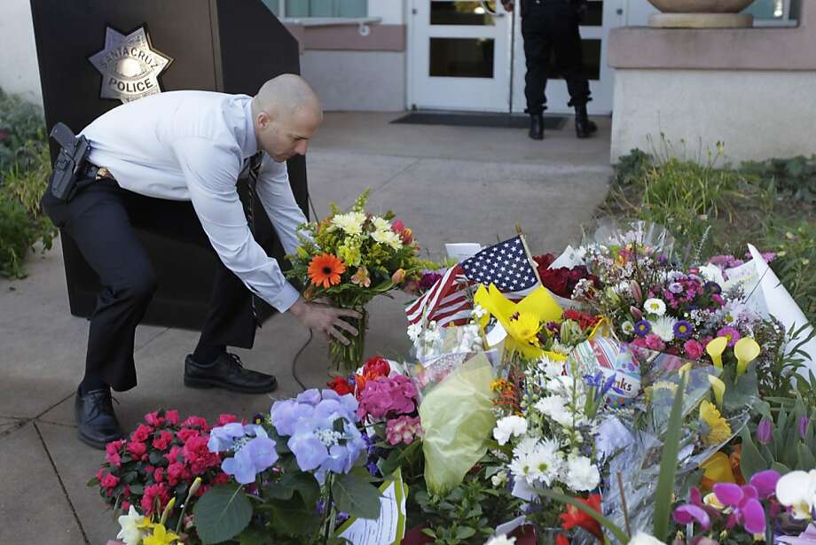 Fremont Detective Josh Ehling honors two slain Santa Cruz officers. Photo: Paul Chinn, The Chronicle