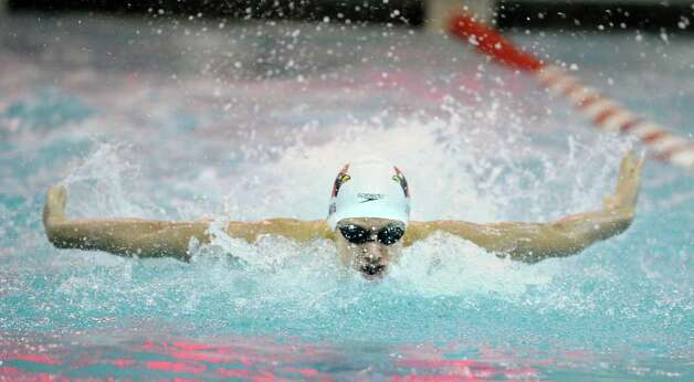 Alex Lewis of Greenwich High School swims the 100 butterfly event during the FCIAC Swimming championships at Greenwich High School, Thursday night, Feb. 28, 2013. Photo: Bob Luckey / Greenwich Time