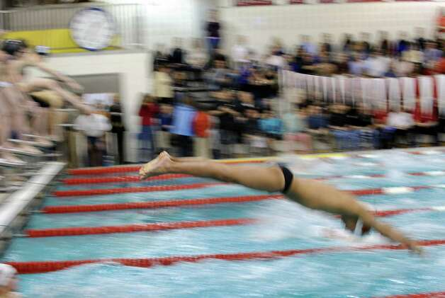 The FCIAC Swimming championships at Greenwich High School, Thursday night, Feb. 28, 2013. Photo: Bob Luckey / Greenwich Time