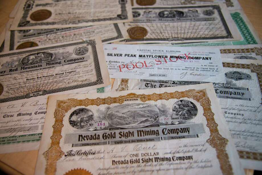 Dick Brothers shows the paper stock certificates he owns that date back to the 1920s. Most are from old silver and gold mining companies with the stock being purchased by Brothers' grandfather in Alaskan and California mining towns.The paper stock certificate is rapidly becoming a piece of a bygone era. (Manny Crisostomo/Sacramento Bee/MCT) Photo: Manny Crisostomo, McClatchy-Tribune News Service / Sacramento Bee