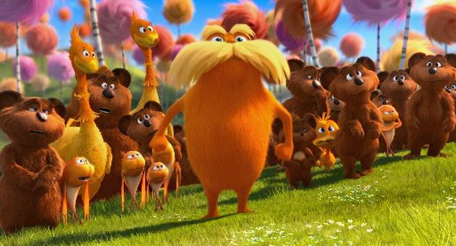 The Lorax stands with the Bar-ba-loots, Swomee-Swans and Humming-Fish. (AP/Universal Pictures)