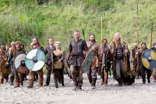 "This image released by History shows Travis Fimmel as Ragnar, center, in a scene from ""Vikings,"" premiering Sunday, March 3 on History. (AP Photo/History, Jonathan Hession) Photo: Jonathan Hession"
