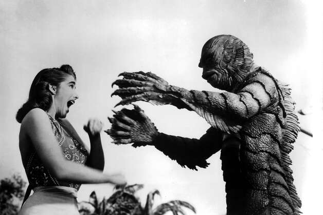 An amphibian-like monster about to attack women in a scene from the film 'Creature From The Black Lagoon', 1954. Photo: Archive Photos, Getty Images / 2011 Getty Images