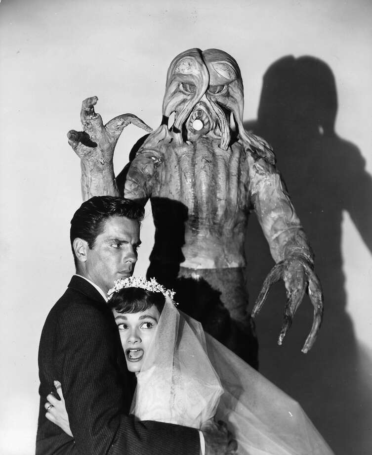 "Monster From Outer SpaceTom Tryon is grabbed by Gloria Talbott in a scene from the film ""I Married A Monster From Outer Space,"" 1958. Photo: Archive Photos, Getty Images / 2011 Getty Images"