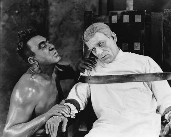 Lon Chaney as Dr Ziska and Walter James as Caliban in 'The Monster', a silent horror film directed by Roland West. Photo: John Kobal Foundation, Getty Images / Moviepix