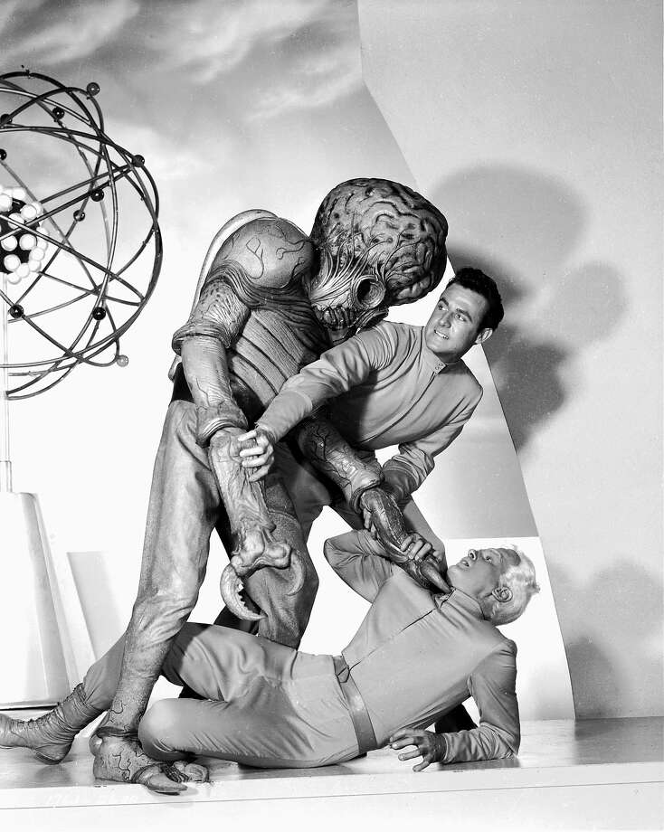 "Metalunan alienRex Reason, Jeff Morrow and an alien mutant fight over the fates of planets Earth and Metaluna in the sci-fi movie 'This Island Earth"" in 1955. Photo: John Kobal Foundation, Getty Images / Moviepix"