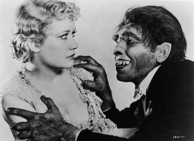 American actor Miriam Hopkins reacts with fright as she is grabbed by the shoulders by actor Fredric Marc, portraying the monster Mr. Hyde, in a still from the film, 'Dr. Jekyll And Mr. Hyde,' directed by Rouben Mamoulian, 1931. Photo: MGM Studios, Getty Images / Moviepix