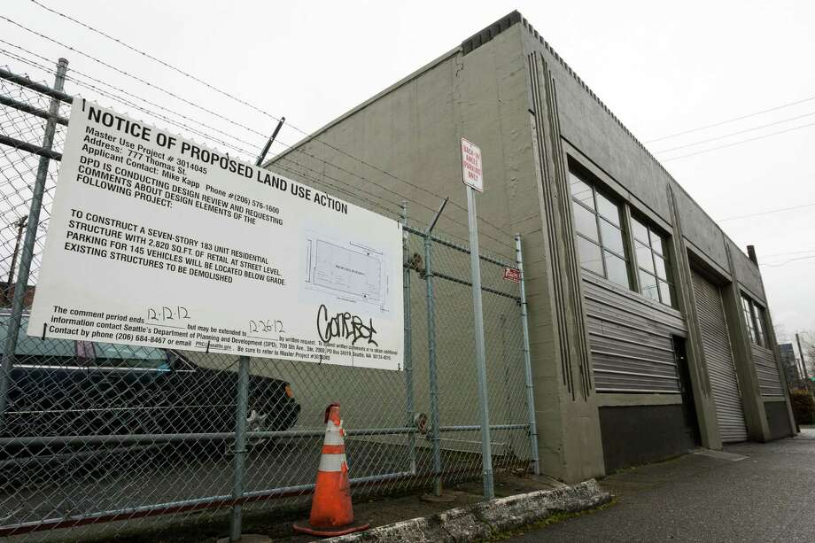 A view of the auto shop located at 777 Thomas Street on Friday, March 1, 2013, in Seattle, Wash. Developers seek to erect an apartment building on the land, but due to the shop's historical stature as a Seattle landmark, the City of Seattle is currently rejecting the idea. Photo: JORDAN STEAD / SEATTLEPI.COM