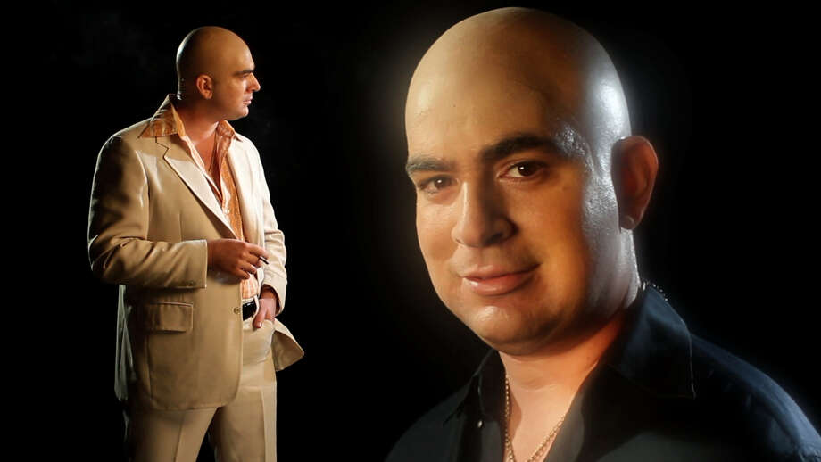 Telly Savalas gets a good look at himself in a relatively new stage show created, in part, by former Darien resident Tom DiMenna. Intrigued? The show will be performed at 7 p.m., Thursday, March 7, 2013, at Joe's Pub in New York City, N.Y. Photo: Contributed Photo