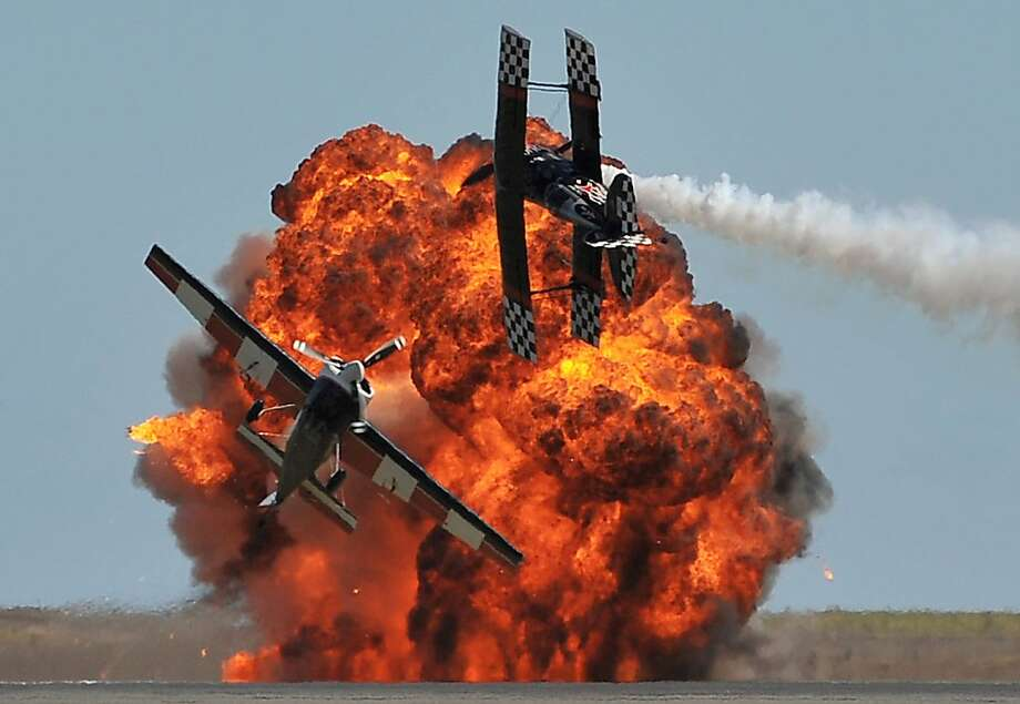 We meant to do that: A fiery explosion adds drama to an aerobatics team's performance during the Australian International Airshow in Melbourne. Photo: Paul Crock, AFP/Getty Images