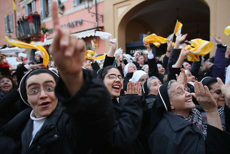 Nuns cheer as Pope Benedict XVI waves to pilgrims for the last time as pontiff from the window of Castel Gandolfo in the Italian city of the same name. If we were the Vatican, we'd keep an eye on the sister at left. Photo: Oli Scarff, Getty Images