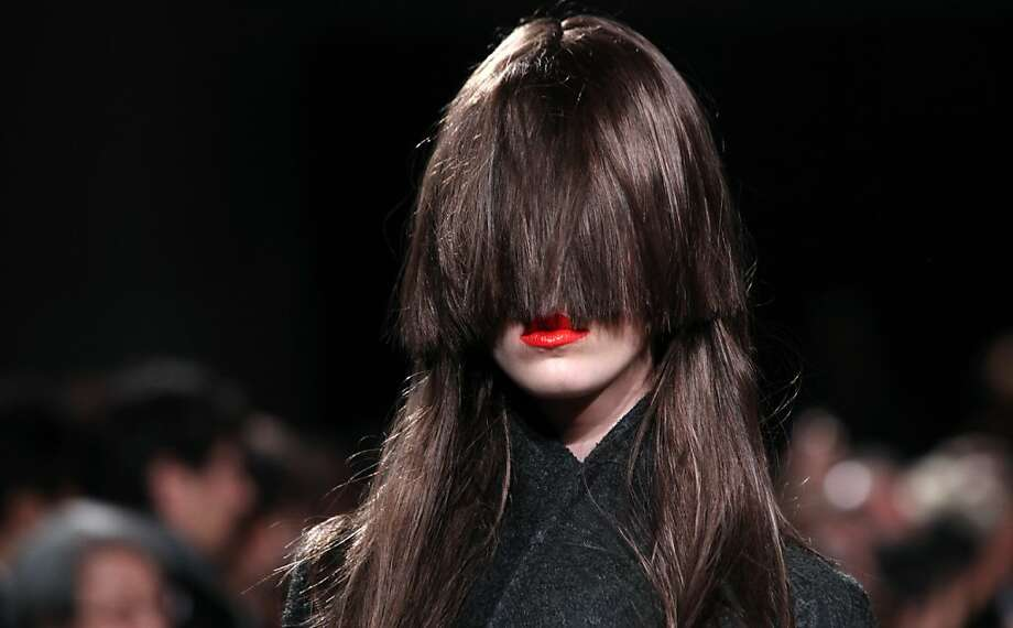 Apparently bangs are still in:A partially blinded model wears a creation by Belgian designer AF Vandevorst at Paris Fashion Week. Photo: Thibault Camus, Associated Press