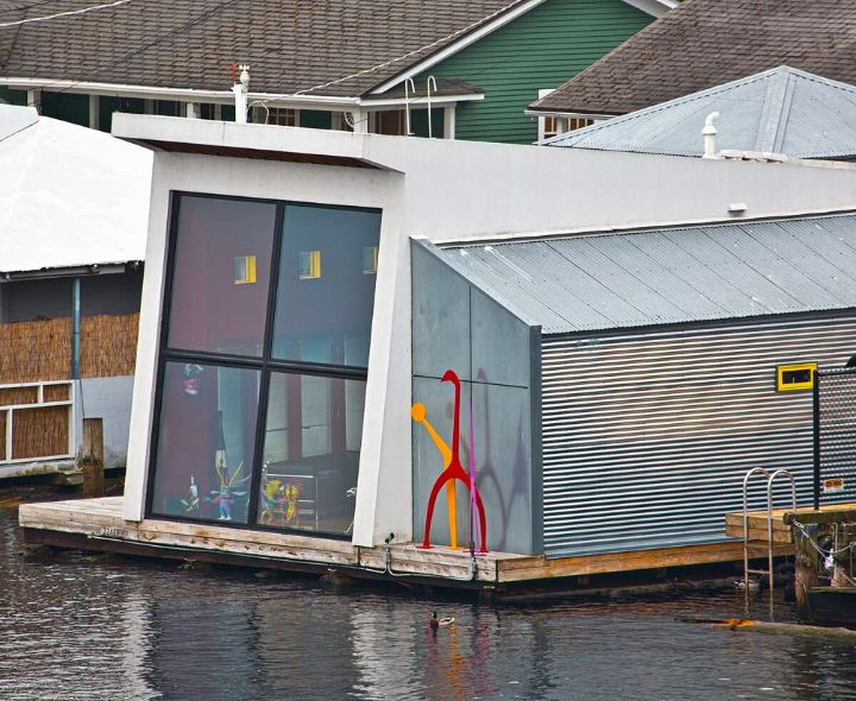 Looking for a whimsical 'industrial chic' home on the water? Behold 3246 Portage Bay Place E., which was the 2001 Seattle Homes & Lifestyle Home of the Year. The 1,200-square-foot floating home, built in 2000, has one bedroom, two three-quarter bathrooms, a wall of slanted windows, an eclectic mix of bright wall colors, vaulted, exposed-wood ceilings and built-in shelves, plus a separate 600-square-foot studio and a 1,200-square-foot guest house on a 6,149-square-foot lot. It's listed for $1.598 million.