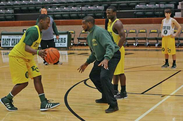 Tramaine Hancock, center, 30, is in his first year being a head coach at East Chambers High School in Winnie. He has led East Chambers to the Class 2A Region IV semifinals. They are the only public school basketball team still in the playoffs.  They were having a late practice Thursday February 28, 2013.   Dave Ryan/The Enterprise Photo: Dave Ryan