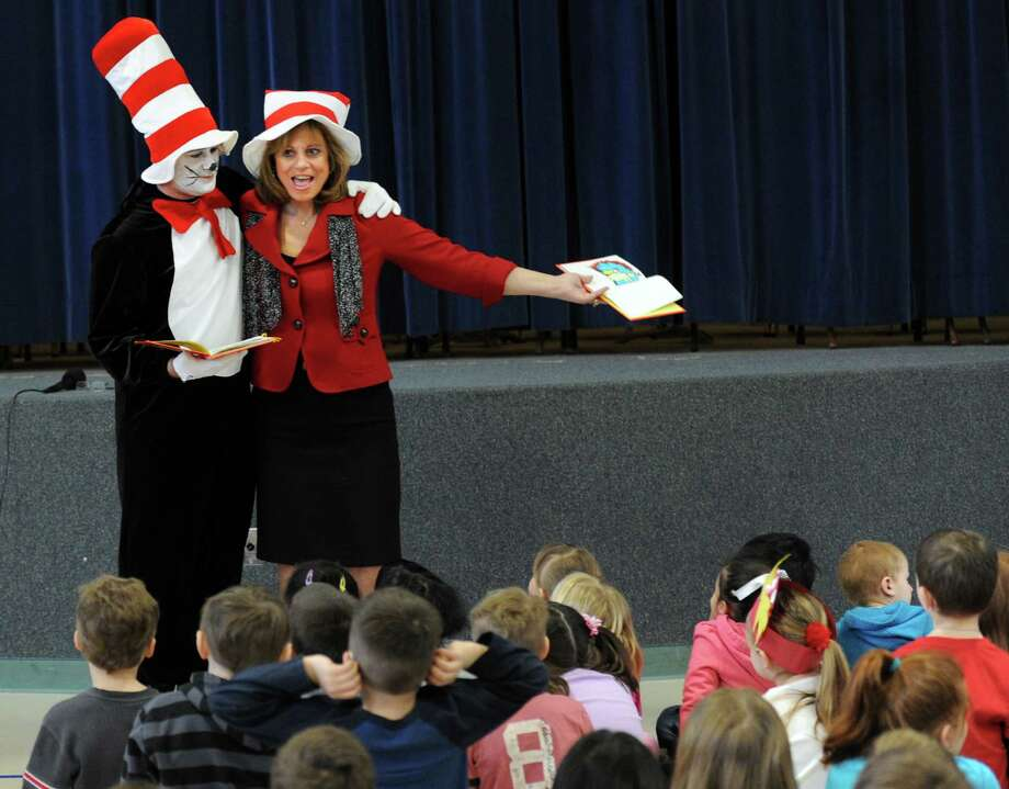 """Sam Pollastro and Principal Mary Sue Feige read """"Green Eggs and Ham"""" to students at Bungay Elementary School in Seymour, Conn. Friday, Mar. 1, 2013 in celebration of Dr. Seuss' birthday. The children's author was born March 2, 1904. Photo: Autumn Driscoll / Connecticut Post"""