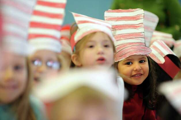 "Kindergarten students at Bungay Elementary School in Seymour, Conn. wear ""The Cat in the Hat"" hats Friday, Mar. 1, 2013 in honor of Dr. Seuss' birthday. The children's author was born March 2, 1904. Photo: Autumn Driscoll / Connecticut Post"