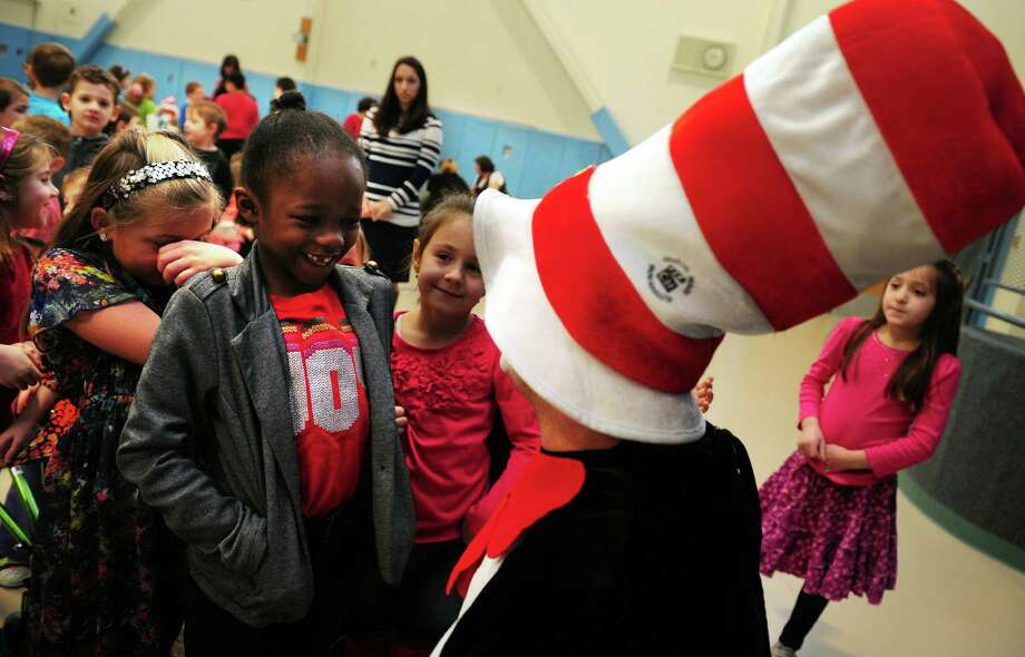 Sam Pollastro, of Derby, makes an appearance as The Cat in the Hat at Bungay Elementary School in Seymour, Conn., where his daughter attends kindergarten, Friday, Mar. 1, 2013 in honor of Dr. Seuss' birthday. The children's author was born March 2, 1904. Photo: Autumn Driscoll / Connecticut Post