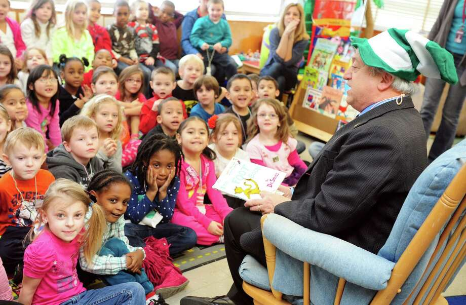 "Derby Mayor Anthony Staffieri reads ""The Foot Book"" to kindergarten students at Bradley Elementary School in Derby, Conn. Friday, Mar. 1, 2013 in honor of Dr. Seuss' birthday. The children's author was born March 2, 1904. Photo: Autumn Driscoll / Connecticut Post"