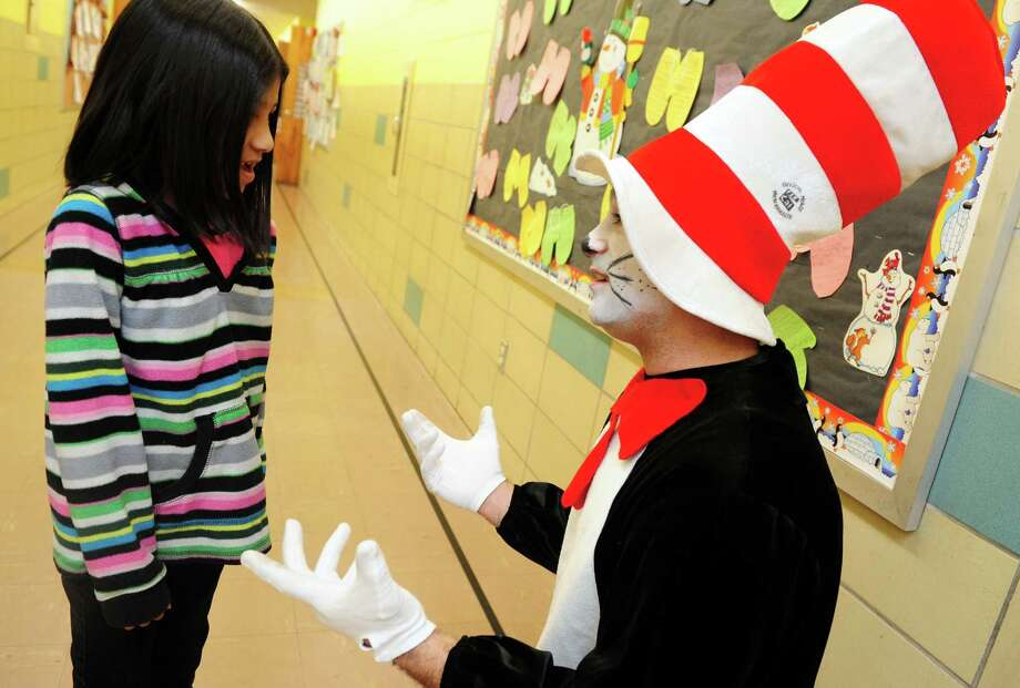 Sam Pollastro, dressed as The Cat in the Hat, talks with second grade student Alexia Lopez during his visit to Bradley Elementary School in Derby, Conn. Friday, Mar. 1, 2013 in honor of Dr. Seuss' birthday. The children's author was born March 2, 1904. Photo: Autumn Driscoll / Connecticut Post