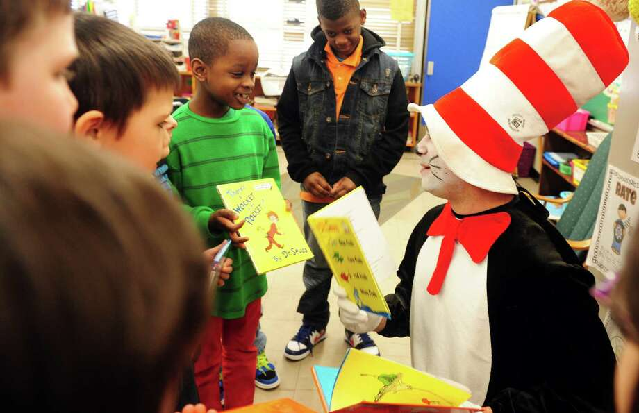 Sam Pollastro, of Derby, makes an appearance as The Cat in the Hat at Bradley Elementary School in Derby, Conn. Friday, Mar. 1, 2013 in honor of Dr. Seuss' birthday. The children's author was born March 2, 1904. Photo: Autumn Driscoll / Connecticut Post