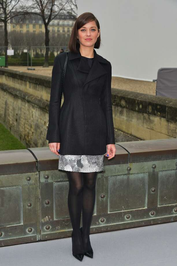 Marion Cotillard arrives at the Christian Dior Fall/Winter 2013 Ready-to-Wear show as part of Paris Fashion Week on March 1, 2013 in Paris, France. Photo: Dominique Charriau, WireImage / 2013 Dominique Charriau