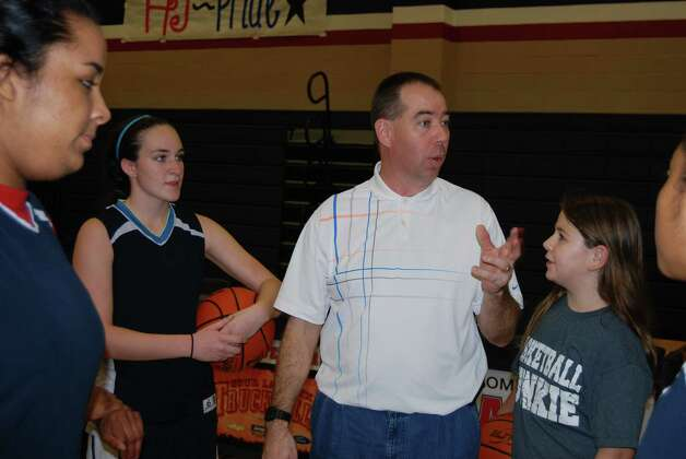Coach Matt Garrett giving his girls a pep talk after practice. Photo: Jay Cockrell / Jay Cockrell
