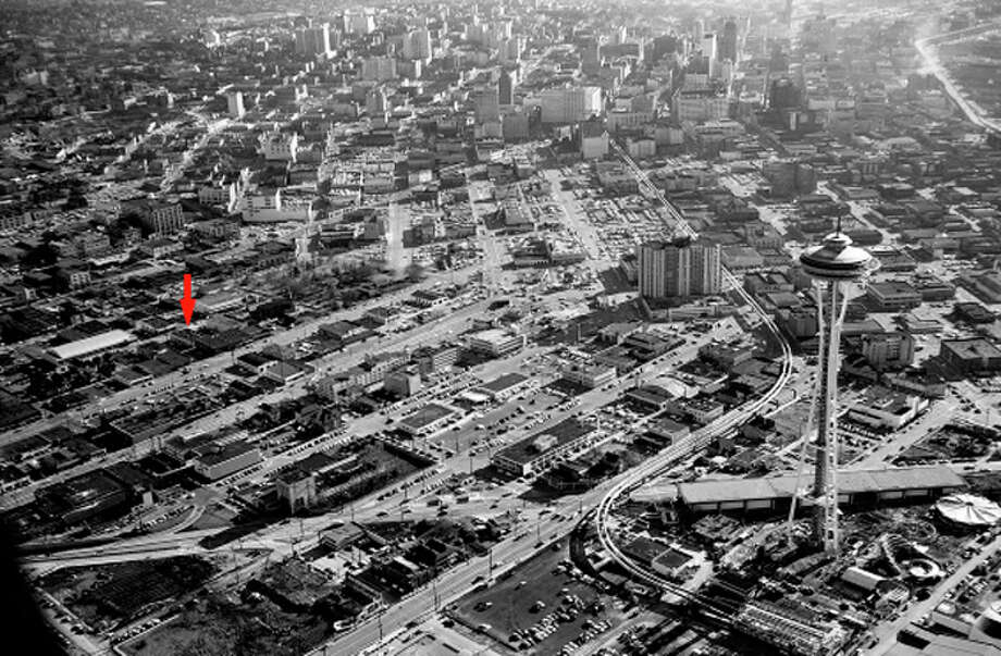 A 1962 photo showing Seattle Center, South Lake Union and downtown Seattle. The red arrow included in an architect's report notes the location of the 777 Thomas Street auto shop. Seattle Municipal Archives photo. Photo: /