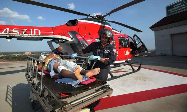 Corey Montgomery, Life Flight Paramedic, wheels one of two critical care patient into the emergency room at Memorial Hermann Hospital in the Medical Center on Friday, Aug. 19, 2011, in Houston.  ( Mayra Beltran / Chronicle ) Photo: Mayra Beltran, Staff / © 2011 Houston Chronicle