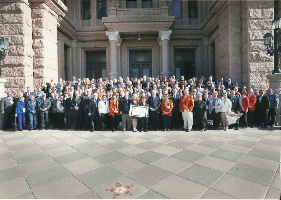 A small army of Southeast Texans lines up for a class photo at the Texas Capitol during the Legislature's 2011 session for Golden Triangle Days. The 2013 event starts Sunday in Austin so regional business and government leaders can advocate for issues of importance in person. Topping the list this year will be windstorm insurance reform. Courtesy photo from the Greater Beaumont Chamber of Commerce. Photo: Courtesy Photo