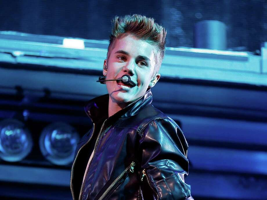 """Justin Bieber had the """"worst birthday ever"""" on Friday, according to his own Twitter feed. The pop star, who just turned 19, left the Cirque du Soir nightclub in London after just a few minutes of arriving, and reports suggested he was have been kicked out. Bieber disputed that on Sunday, posting on Instagram, """"I love how the club wanted to give the press another reason to why we didn't stay at their weak-ass club, so they wouldn't look bad for me walking in and right back out.""""  A spokesman for the club, however, told The Guardian that Bieber and his entourage left because some members of the group were too young to enter. """"We are very sorry, and understand it's (Bieber's) birthday, but our hands are tied,"""" the spokesman said.  The paparazzi reportedly followed the party to a nearby McDonald's before Bieber and his friends headed back to his hotel. Photo: Isaac Brekken, Associated Press / Invision"""
