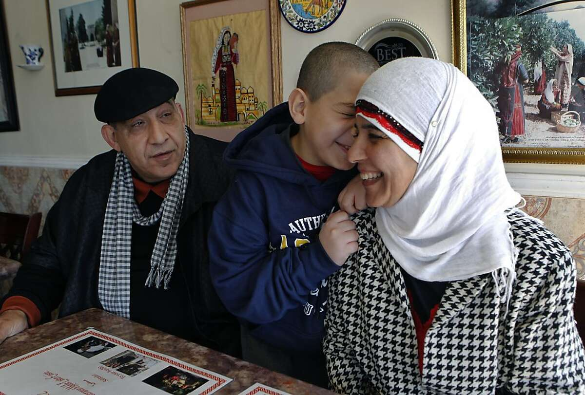 Naime Ayyad and his wife Fayza, shown with their youngest son, Amir, 9, run the Zaki Kabob House restaurant in Albany.