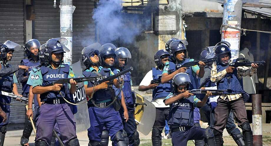 Bangladeshi policemen disperse protesters in Rajshahi, Bangladesh, Friday, March 1, 2013. Protesters clashed with police for a second day Friday as the death toll rose to at least 44 in clashes triggered by a death sentence given to Delwar Hossain Sayedee, one of the top leaders of the country's largest Islamic party Jamaat-e-Islami, for crimes linked to Bangladesh's 1971 independence war, police said. (AP Photo) Photo: Associated Press